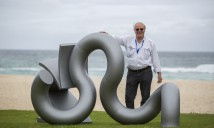 Michael Le Grand with his sculpture recoil, Sculpture by the Sea, Bondi 2015. Photo Gareth Carr