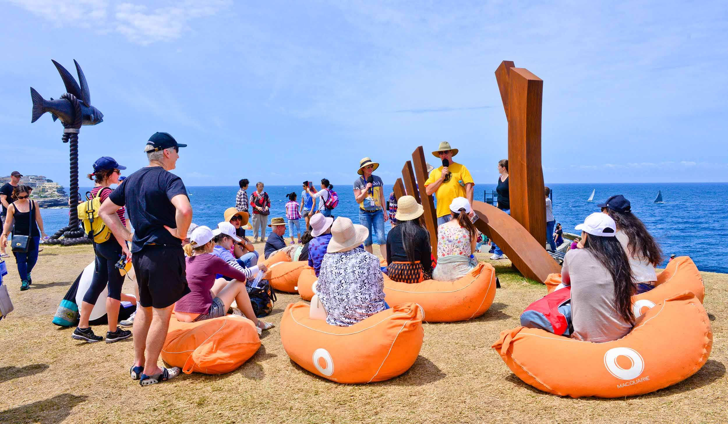 Linda Bowden talking with her sculpture at the Macquarie Artist Talks, Sculpture by the Sea, Bondi 2015. Photo Clyde Yee