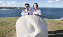 Mr Jin Lin, Managing Director of Aqualand & Mr David Handley AM, Founding Director of Sculpture by the Sea with 'Moon Buddha' by Vince Vozzo on south Bondi Beach headland on July 5, 2016 in Sydney, Australia. Aqualand is the new Principal Sponsor for the world's largest sculpture exhibition - Sculpture by the Sea, Bondi.