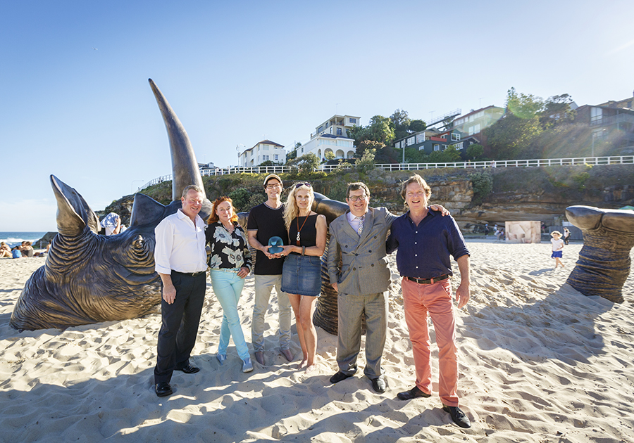 Rebel Penfold Russell OAM, Ross Drinnan, Marc and Gillie Schattner, Andrew Bell and David Handley in front of Buried Rhino, Sculpture by the Sea, Bondi 2016.